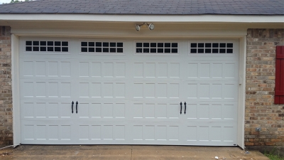 white metal garage door repair