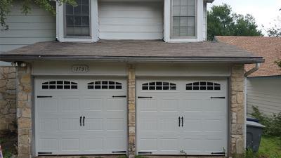 dual white garage doors