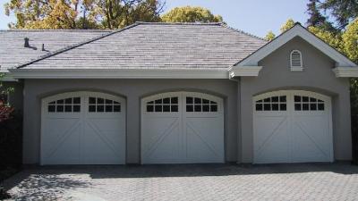 3 car white garage doors